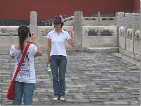 Chinese tourists with the Peace Sign